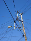 Power poles with many wires Royalty Free Stock Images