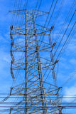 Power poles and power lines. High voltage power pole at large . With blue sky stock photo