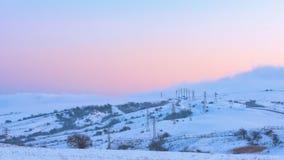 Power poles in a snowy field, winter scene. Power poles in a snowy field, winter landscape royalty free stock image