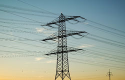Power poles at sunset Royalty Free Stock Photo