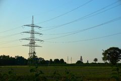 Power poles in a sunset stock photo