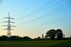 Power poles in a sunset stock image