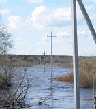 Power poles in the water Stock Photos