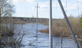 Power poles in the water Stock Photo