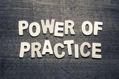 Power of Practice. By wood letters on wood background Stock Photo
