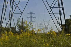 Power on the Prairie. Electrical transmission towers and lines spanning the prairie stock image