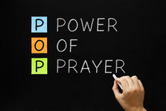 Power of Prayer. Hand writing POP - Power Of Prayer with white chalk on blackboard stock photo