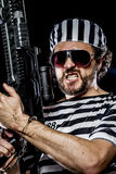 Power, Prison riot concept. Man holding a machine gun, prisoner Royalty Free Stock Photos