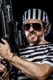 Power, Prison riot concept. Man holding a machine gun, prisoner Royalty Free Stock Photos
