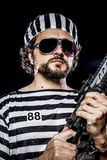 Power, Prison riot concept. Man holding a machine gun, prisoner Royalty Free Stock Photography