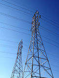 Power Pylon. Two power pylons against a clear blue sky royalty free stock photography