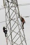 Power pylon. Workers climbing on power pylon Royalty Free Stock Photo