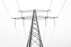 Power pylon. From below on a foggy morning in the Netherlands royalty free stock photography