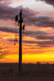Power pylon with broken lines in the dusk. Single pylon with broken power lines hanging on it in dusk Royalty Free Stock Image