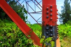 Power pylon detail. Electricity pylon elements close-up in details Stock Photo