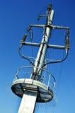 Power pylon over blue sky Royalty Free Stock Photo