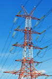 Power pylon over blue sky. Electrical transmission tower.  royalty free stock photos