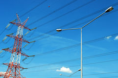 Power pylon over blue sky. Electrical transmission tower.  stock images