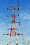 Power pylon over blue sky. Electrical transmission tower Stock Photo