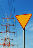 Power pylon over blue sky. Electrical transmission tower.  stock photo