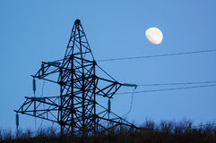 Power pylon silhouette and moon Stock Photo