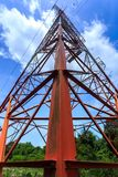 Power pylon. Super wide angle photograph of Electricity pylon with blue sky Royalty Free Stock Images
