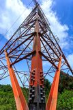 Power pylon. Super wide angle photograph of Electricity pylon with blue sky Stock Image