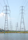 Power pylons. High power electricity cables cross an estuary Royalty Free Stock Photo