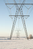 Power Pylons Against the Blue Sky Stock Images