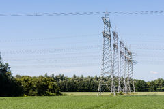 Power pylons and high voltage lines Stock Photos