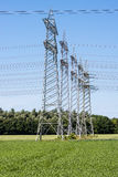 Power pylons and high voltage lines Stock Photography