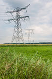 Power pylons in a rural Dutch area Royalty Free Stock Photo