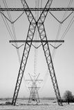 Power Pylons in the Snow Stock Photo