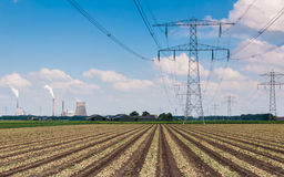 Power pylons and station in a rural landscape Stock Photo