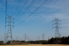 Power pylons and wires Royalty Free Stock Images
