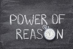 Power of reason watch. Power of reason phrase written on chalkboard with vintage precise stopwatch stock photography