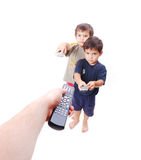 Power of remote control. Two kids and their father holding remote controlers Stock Images