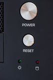 Power and reset button on desktop pc panel. Close up of power and reset button on desktop pc panel. Selective focus Stock Image