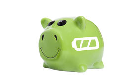 Power saving concept. Close up of piggy bank with battery symbol Royalty Free Stock Photos