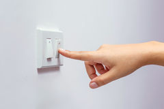 Power saving. Switch off power hand button Stock Photo