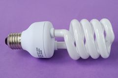 Power saving up lamp. Big power saving up lamp on violet background Stock Photography