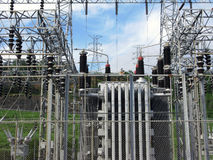 Power scource. Dam substation with high voltage lines and towers in background stock photos