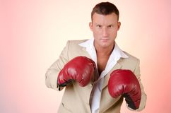 Business and success. Office fight. Young man in boxing gloves. Work and the battle. Power and sexy. Fitness and healthy lifestyle. Sport and diet Royalty Free Stock Image