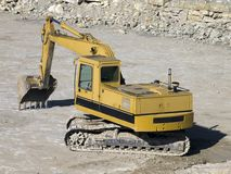 Power shovel. Yellow digger in a quarry royalty free stock image