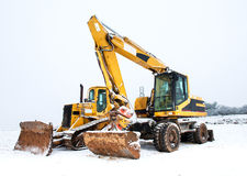 Power shovel and bulldozer in snow Royalty Free Stock Photo