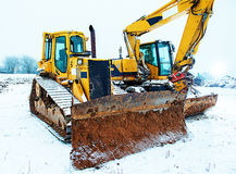 Power shovel and bulldozer in snow Stock Image