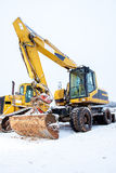 Power shovel and bulldozer in snow Stock Photography