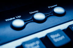 Power sleep buttons. Power and sleep buttons on keyboard - blue toned Royalty Free Stock Photography