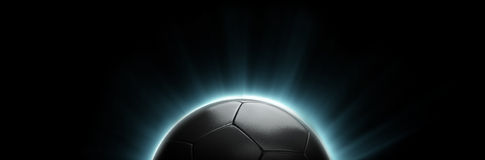 Power Soccer Football Flare. Dark iron soccer ball with blue flares or power streaks. Ideal for soccer related designs and layouts Royalty Free Stock Photo