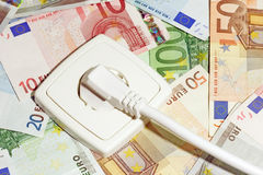Power socket and Banknotes Stock Photo